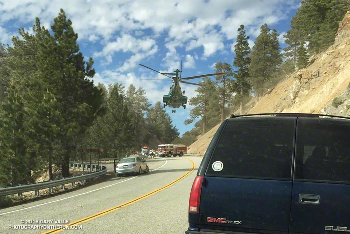 Air Rescue 5 airlifts a traffic accident victim from a tight spot on Angeles Crest Highway.