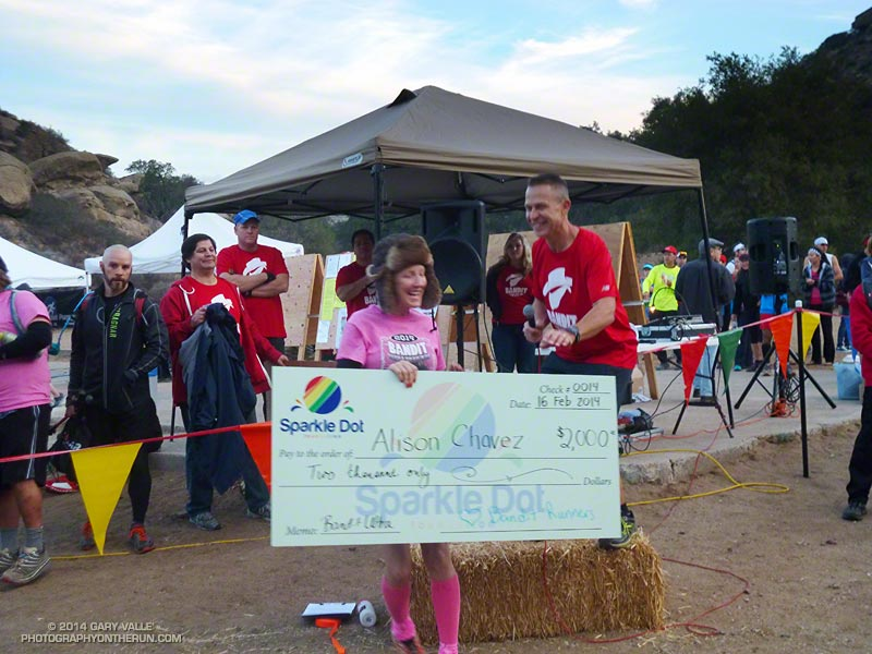 Bandit Trail Runs race director Randy Shoemaker presents a check to Alison Chavez to help in her battle against cancer. A dedicated runner, Alison ran and completed the Bandit 30K.