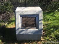 Marker recognizing the significant contributions from Governor Arnold Schwarzenegger and Betty Weider in the creation of the Backbone Trail