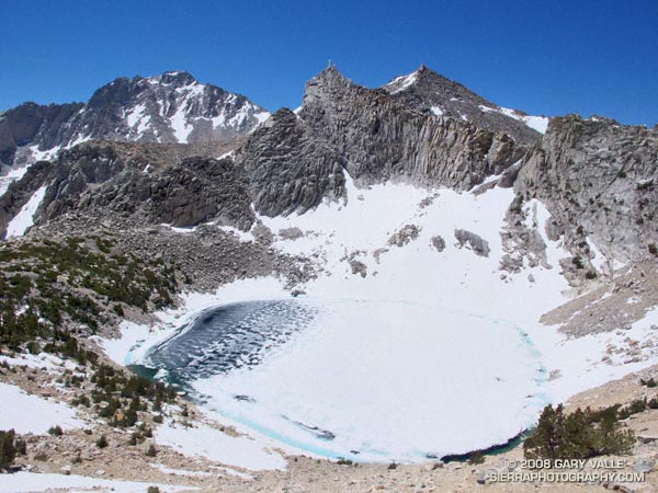 Big Pothole Lake from the east side of Kearsarge Pass. Nameless Pyramid (right) and University Peak (left) on the skyline.