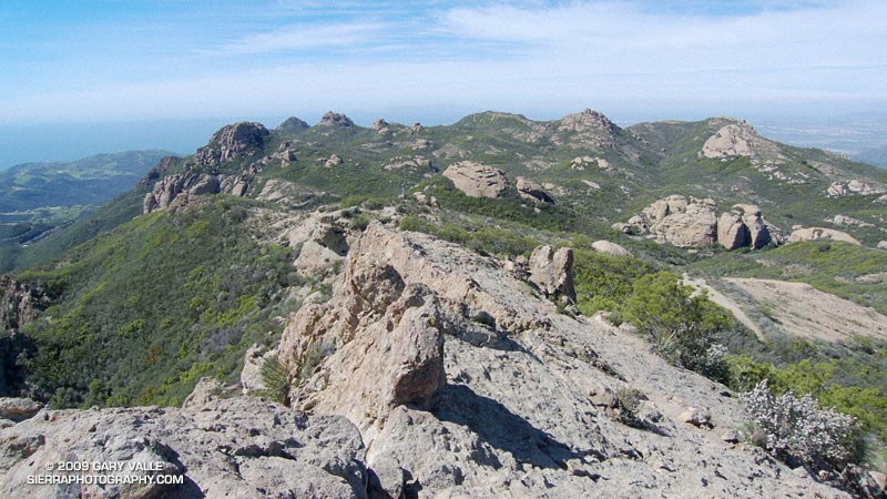 View west from Sandstone Peak of the Boney Mountain summit area. Tri-Peaks is the rocky peak on the skyline, right of center, and Big Dome is to the right of Tri-Peaks.
