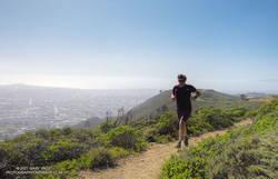 Brett running up the Summit Loop Trail on San Bruno Mountain