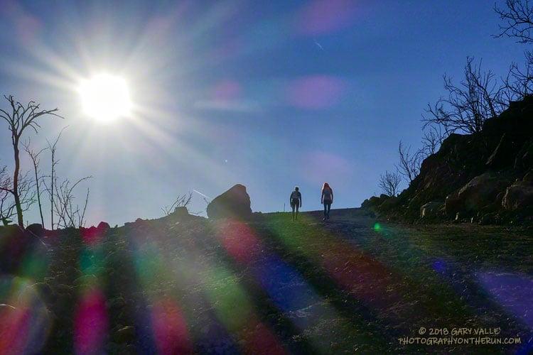 Runners ascending Bulldog Mtwy following the Woolsey Fire