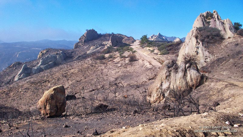 Area along Mesa Peak Motorway, east of Corral Canyon, burned by the Corral Fire,