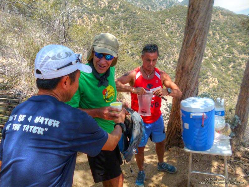 2013 AC100 finishers Dave Tan and Rainer Schultz assist Craig Kinard at the