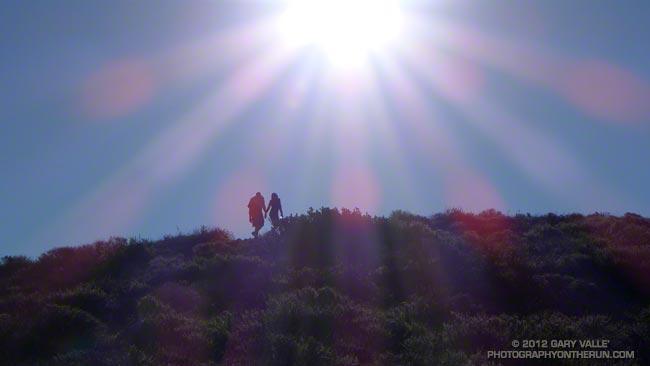 Hikers nearing the summit of Mugu Peak