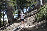 Trail runner descending the PCT near Mt. Burnham.