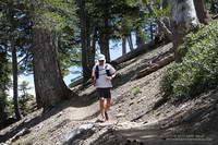 Trail runner descending the PCT near Mt. Burnham.