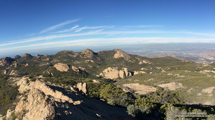 View west from Sandstone Peak of the cold front near Santa Barbara. Tri Peaks is the rocky peak on the skyline, left of center, and Big Dome is to the right of Tri Peaks. The route up the western ridge tops out on the crest between these two peaks. Mostly clear; 9:35 AM.