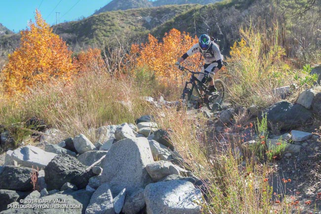 Downhill mountain biker on a technical single-track trail in the San Gabriel Mountains.