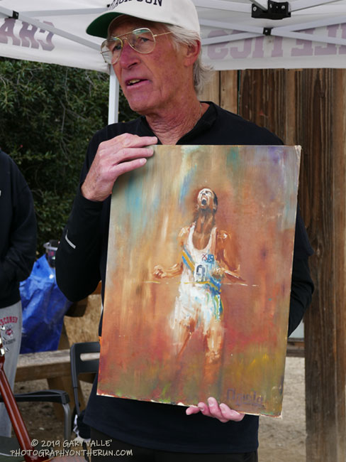 Jon with the original oil painting by Tom Ogiela of Herb Elliott's Gold Medal finish in the 1500m in the 1960 Rome Olympics.