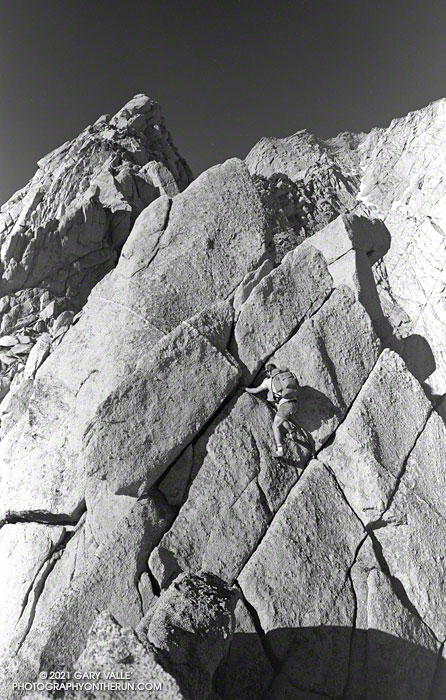 Phil Warrender climbing the first of a series of towers on the Northeast Ridge of Lone Pine Peak. July 11, 1982.