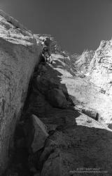 Phil Warrender climbs a feldspar dike on the Northeast Ridge of Lone Pine Peak. July 1982.