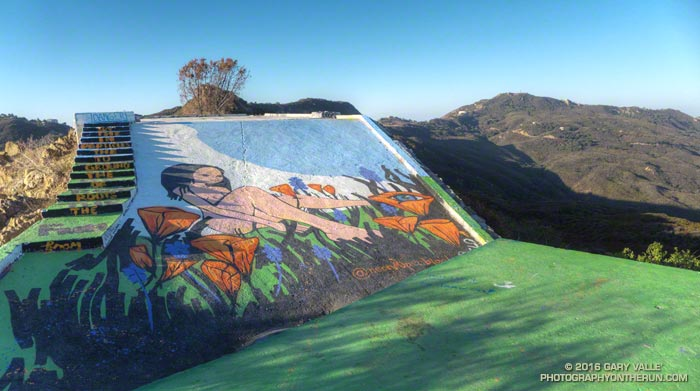 Artwork at Topanga Lookout created by @neonsuperblack. Saddle Peak in the background.