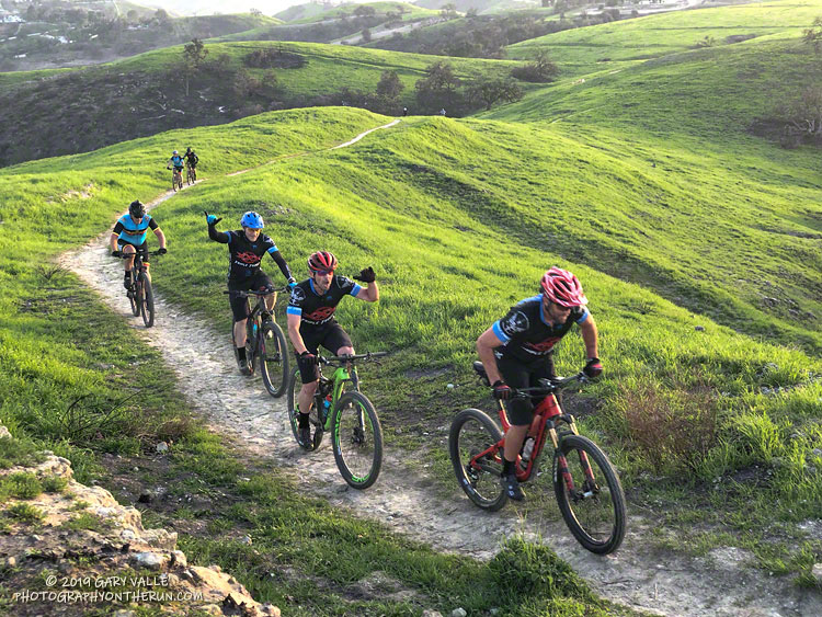 Mountain bikers climbing a small hill at Ahmanson Ranch