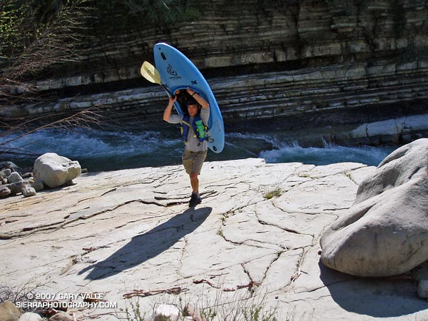 One solution for carrying a kayak a few miles upstream.