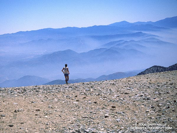 A runner begins the descent from Mt. Baldy.