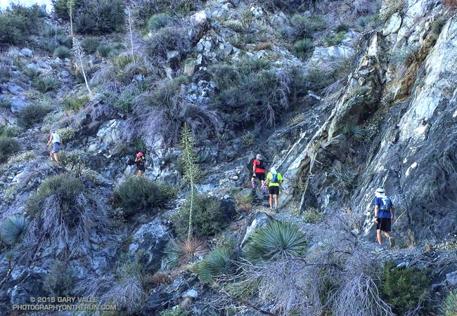 Runners work up the San Gabriel Peak Trail toward Mt. Disappointment.