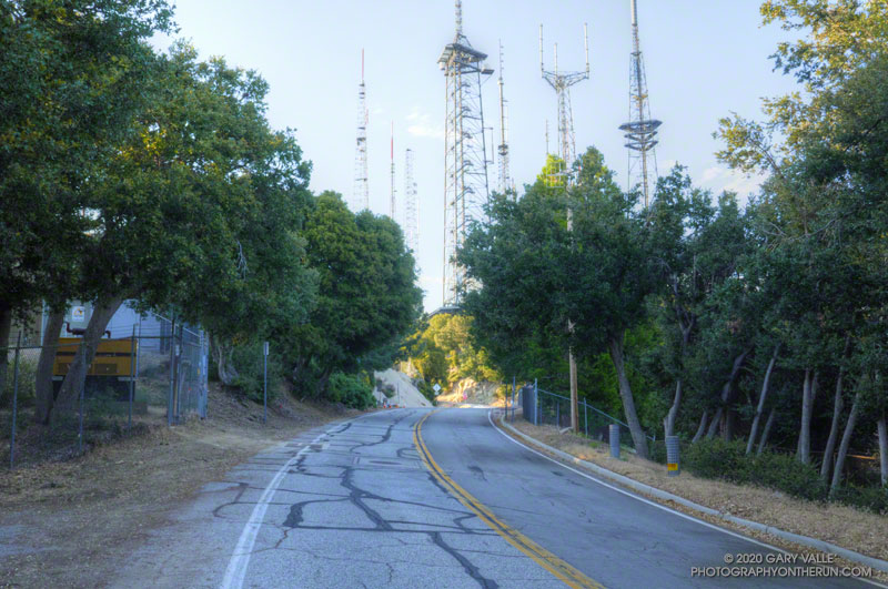 Looking back at an empty Mt. Wilson road and some of the antennas on top of Mt. Wilson. This set of antennas can be seen from the West Fork, Gabrielino and Kenyon Devore Trails and used to mark the top of the Kenyon Devore Trail.