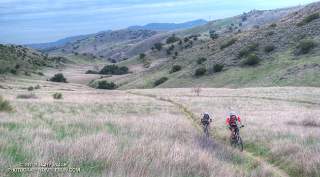 Mountain bikers cranking up a canyon near Las Virgenes Creek.