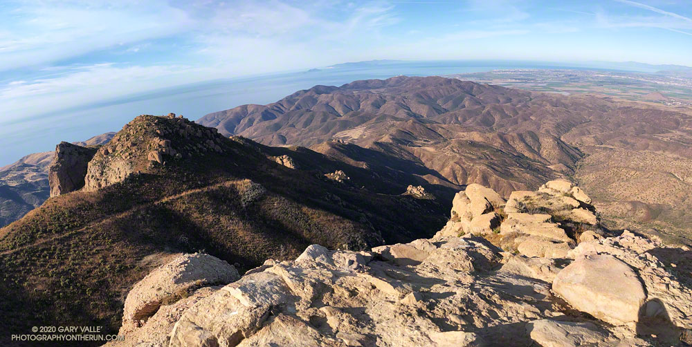 View west from Boney Bluff across Big Sycamore Canyon to La Jolla Valley, Mugu and Laguna Peaks, to the Channel Islands. Peak 2880 and the Chamberlain segment of the Backbone Trail is on the left. The Oxnard Plain and mountains of Santa Barbara are on the right. November 21, 2020.