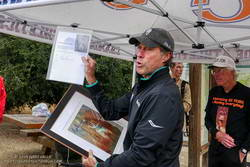 Four-time Olympian, Rod Dixon, presents Jon Sutherland with a print of a painting by Tom Ogiela of Herb Elliott's world record-setting gold medal finish in the 1500m in the 1960 Rome Olympics.