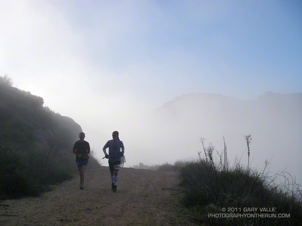 50K runners climbing back up Rocky Peak Road after descending to Santa Susana Pass, about three miles into the race.