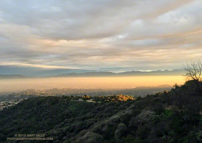 The rising sun illuminates a translucent layer of cloud trapped by a shallow inversion in the San Fernando Valley
