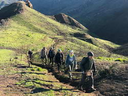 Members of the Santa Monica Mountains Trail Council (SMMTC) approaching the junction of the Old Boney and Chamberlain Trails.