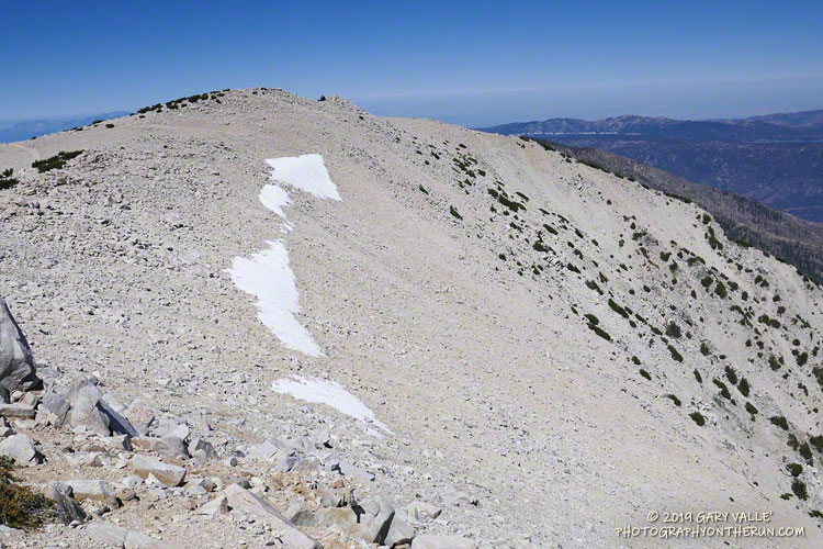 Snow band at the top of a northeast-facing cirque near the summit of San Gorgonio Mountain. September 7, 2019.
