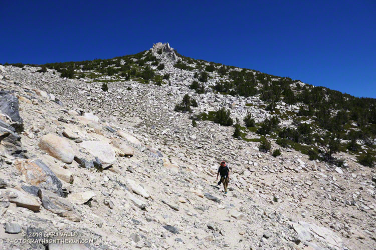 Hiker working up the Sky High Trail on San Gorgonio Mountain in Southern California