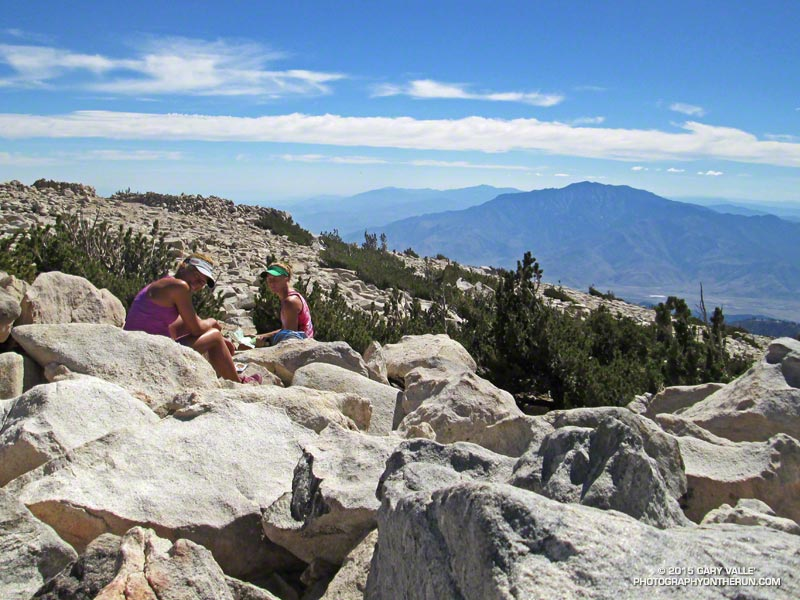 Patty and Ann relax on the summit of 11,503' San Gorgonio Mountain. San Jacinto Peak (10,843') sits across Banning Pass from San Gorgonio.