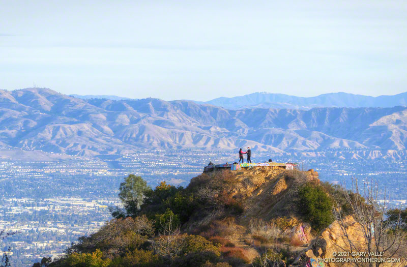 With the San Fernando Valley as a backdrop, a couple dances at Topanga Lookout, during the pandemic