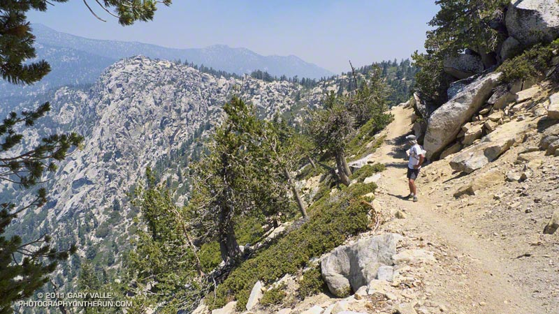 Trail below the summit of Tahquitz Peak. San Jacinto is hidden from view by Jean Peak, high on the left skyline. The Palm Springs Tram is behind the ridge and peaks on the right skyline.
