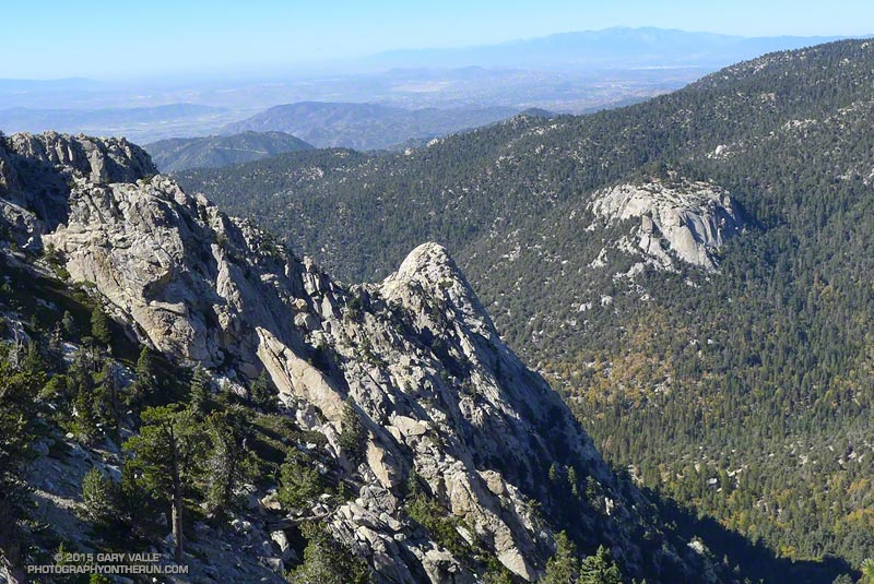 Tahquitz Rock (at the end of the ridge) and Suicide Rock (across the valley) from the South Ridge Trail. Mt. Baldy and surrounding peaks can be seen in the distance.