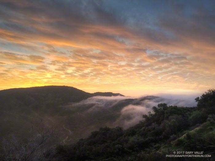 Marine layer spilling over the the crest of the Santa Monica Mountains into Caballero Canyon.