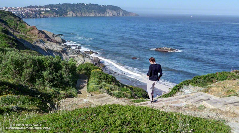 Brett running down the Batteries to Bluffs Trail toward Marshall's Beach and Battery Crosby.