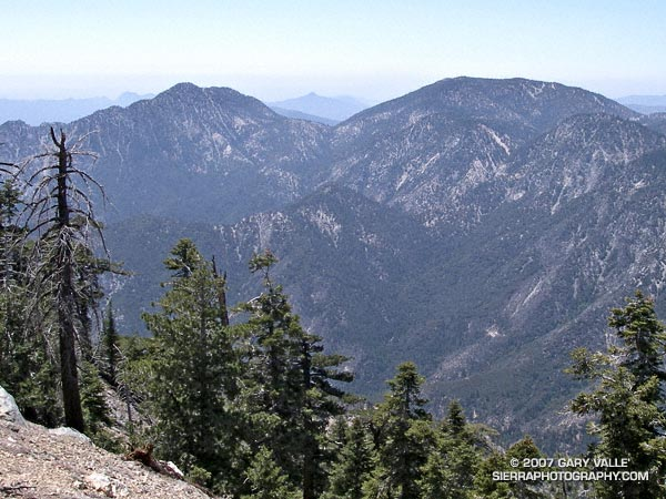 Twin Peaks (left) and Mt. Waterman from the northwest ridge of Mt. Islip. Strawberry Peak is visible in the distance in the gap between the two peaks.