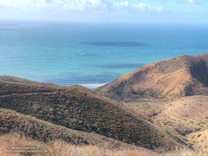 The Ray Miller segment of the Backbone Trail winds down to a very windy Pacific Ocean at La Jolla Canyon. From the Overlook Fire Road at about mile 15 of the run. November 8, 2020.